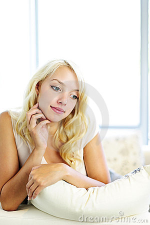 Thoughtful young woman on couch