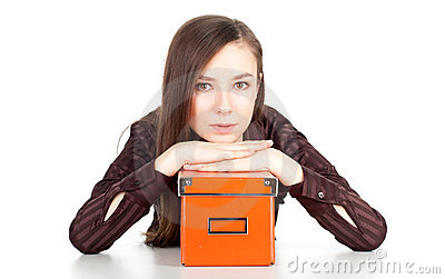 Thoughtful young woman keeping orange box