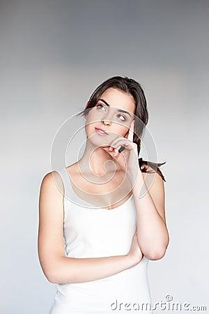 Thoughtfull young casual caucasian girl