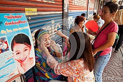 Threading in Chinatown Bangkok. Editorial Photo