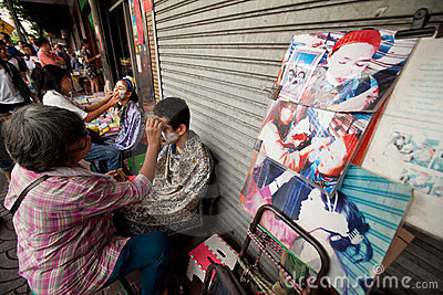 Threading in Chinatown Bangkok. Editorial Stock Image