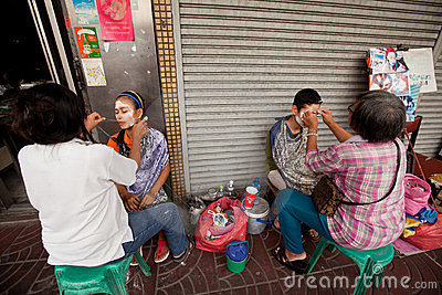Threading (hair removal) in Chinatown Editorial Photo