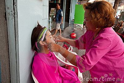 Threading (hair removal) in Chinatown Bangkok. Editorial Photo