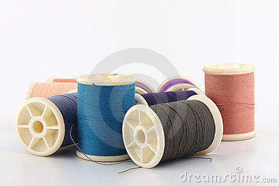 Threads in spools on white
