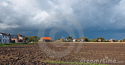 Threatening clouds over a plowed field in autumn