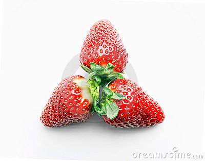 Three strawberries on the white background