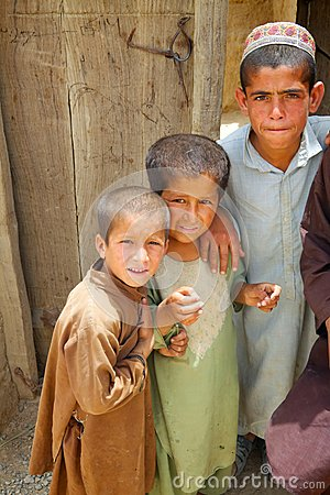 Free Three Afghan Kids Watch An ISAF Patrol Stock Image - 35236291