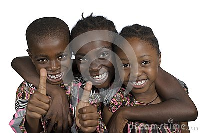 Three african kids holding thumbs up