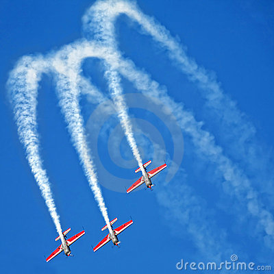 Three airplanes Extra EA-300 on airshow Editorial Stock Image