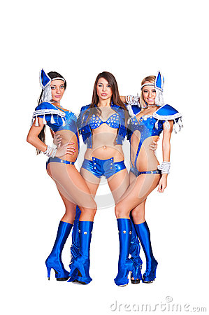 Three alluring dancers in blue club costumes