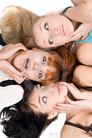 Three amazed women touching their cheeks