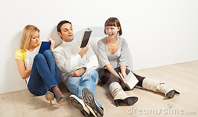 Three amused friends with books