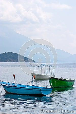 Three anchored boats