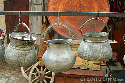 Three antique pots hanging