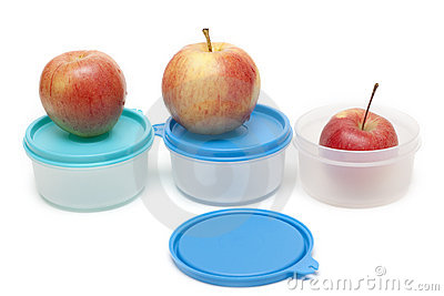 Three apples and plastic containers