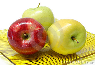 Three apples in a plate