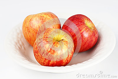 Three apples in white bowl