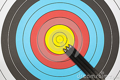 Three arrows on archery target