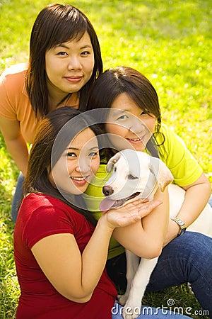 Three Asian Girls And Dog