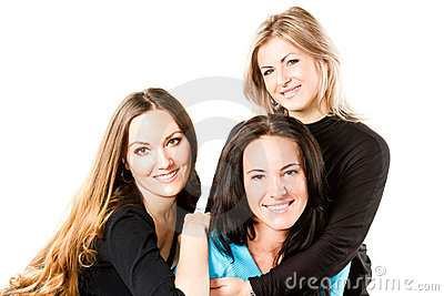 three attractive young  smiling women