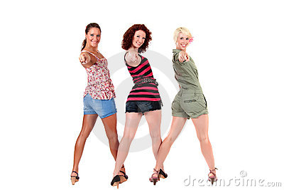 Three attractive young women pointing
