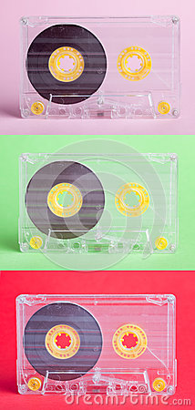 Three audio cassettes on difrent backgrounds