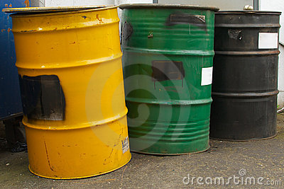 Three barrels in a row, yellow, green and black