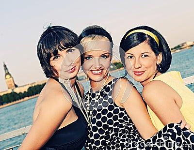 Three bautiful woman outdoors