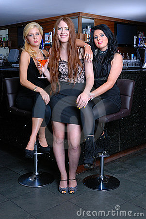 Three beautiful girls in bar