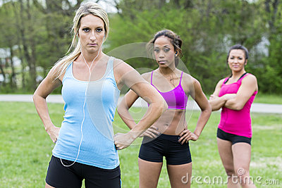 Three beautiful woman prepare to run