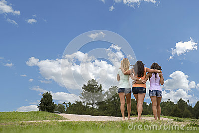 Three beautiful woman walk in the park