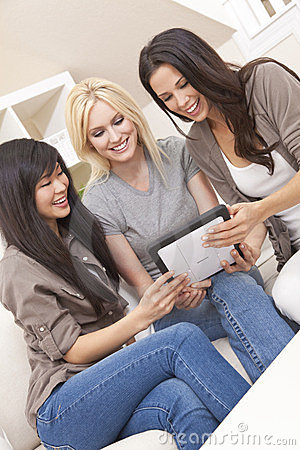 Three Beautiful Women Friends With Tablet Computer