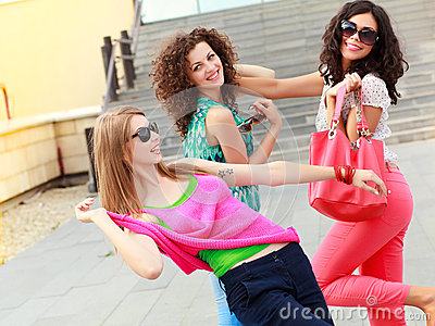 Three beautiful women laughing and having fun