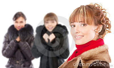 Three beautiful women in winter coats