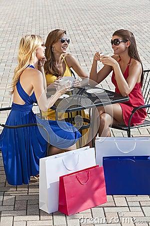 Three Beautiful Young Women Having Coffee