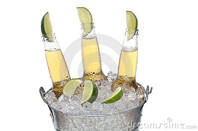 Three Beer Bottles with Limes