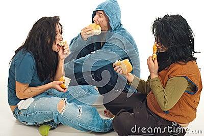 Three beggars sharing a bread