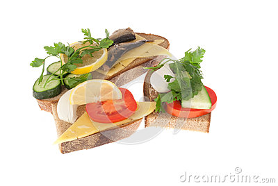 Three bits rye-bread with canned fish and cheese