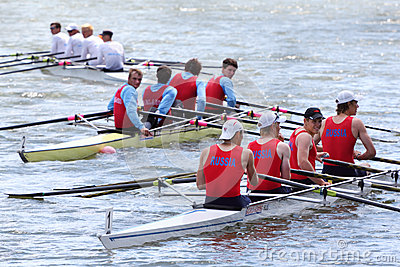 Three boats with four men teams rowing Editorial Stock Image