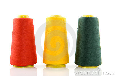 Three bobbins with threads