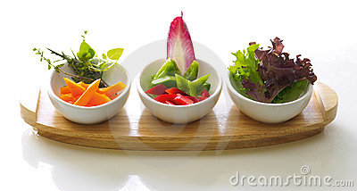 Three bowls of salad