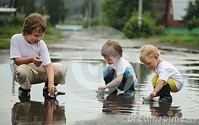 Three boy play in water