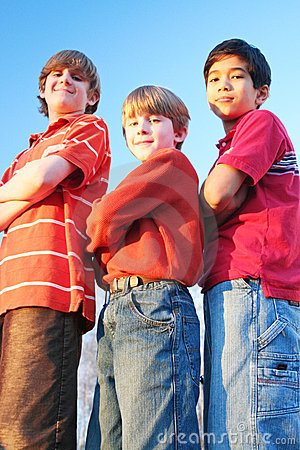 Three boys standing arms crossed