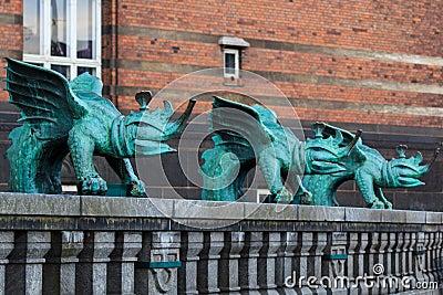 Three bronze dragons
