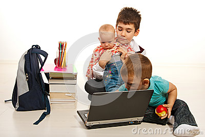 Three   brothers using laptop