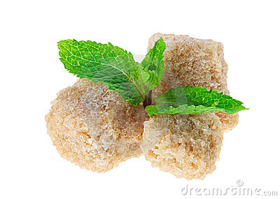 Three brown lump cane sugar cubes with peppermint