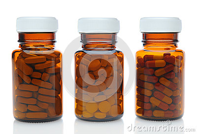 Three Brown Medicine Bottles With Different Drugs