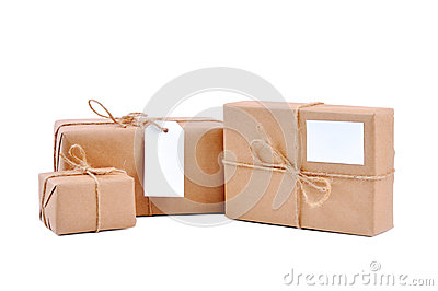 Three brown packages with blank labels