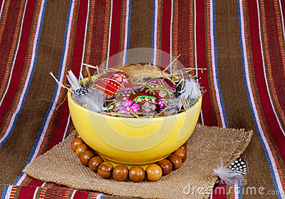 Painted Easter eggs yellow soup plate