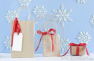 Three brown paper bags